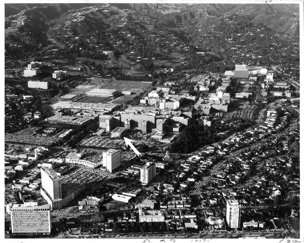 Aerial view of University of California, Los Angeles, Westwood Village, Bel Air, Jules Stein Eye Institute, UCLA Center for Health Sciences, ca. 1975