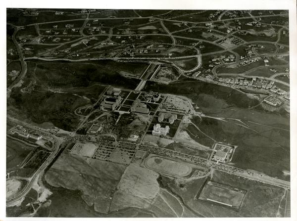 Aerial view of Westwood campus, esplanade, arroyo, and bridge, ca. 1930's