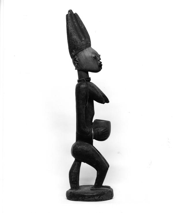 Side view of unidentified statue