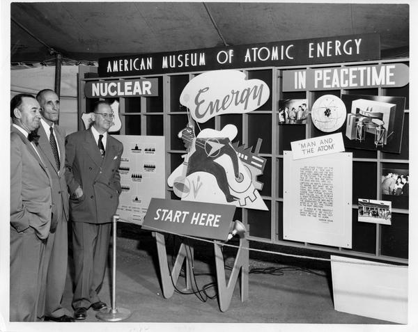 Officials inspect exhibit which introduces the traveling Atomic Energy Exhibit at its premiere showing in Birmingham, Alabama