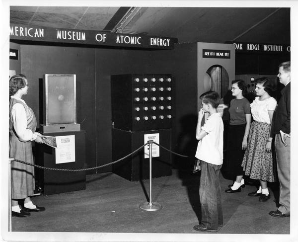 Students view the Dunning exhibit at the traveling Atomic Energy Exhibit, 1951
