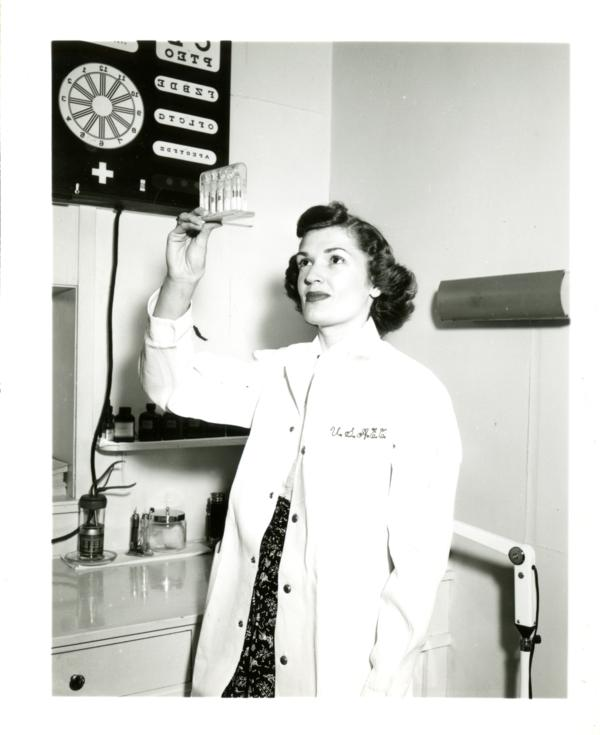 Frances Miller of the Atomic Energy Project holds up an atomic radiation indicator