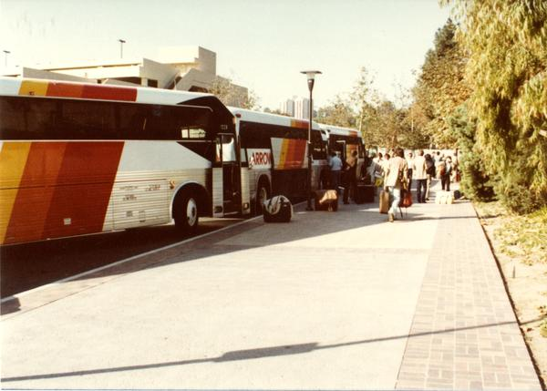 Band members boarding Arrow charter bus at UCLA