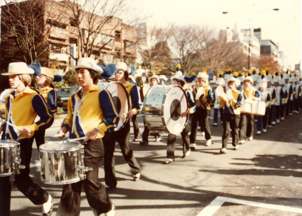 Band members marching on street