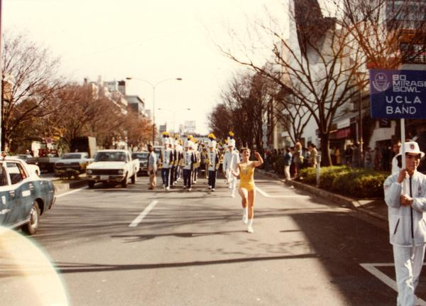 UCLA marching band marching on street for 80 Mirage Bowl