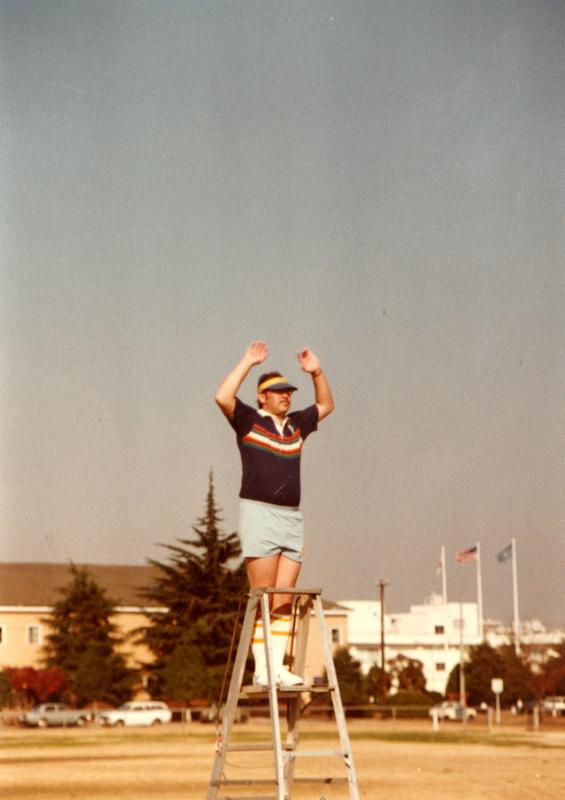 Marching band leader on ladder