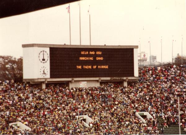 "Scoreboard displaying ""UCLA and OSU Marching Band The Theme of Mirage"""