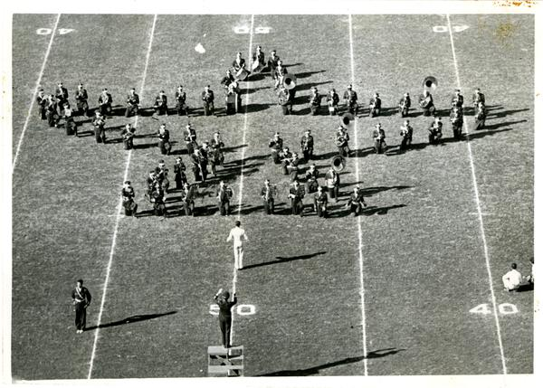 View of marching band performing and forming star shape