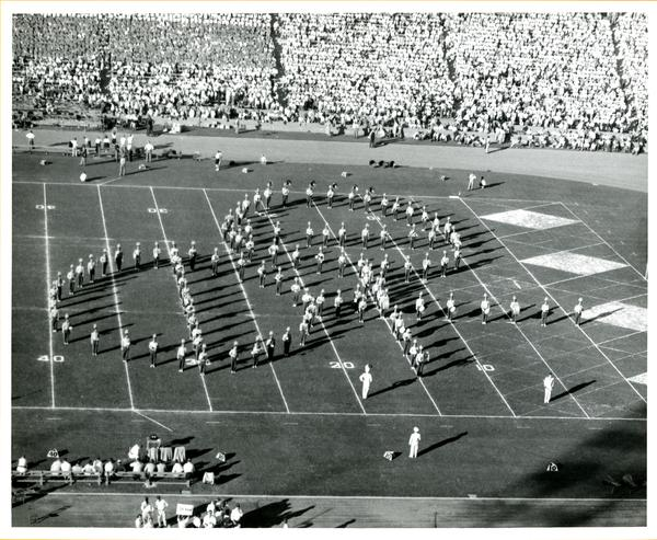 UCLA Marching band performing and forming shape