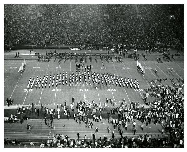 Marching band march in formation at UCLA vs. USC game, 1972