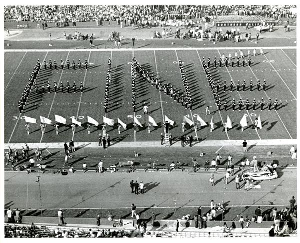 "UCLA Marching Band march in formation of ""FINE"", Farewell to Clarence Sawhill at UCLA vs. USC game, 1971"