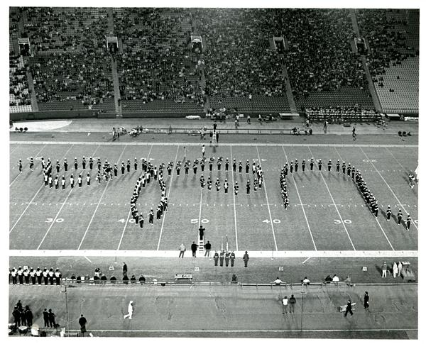 Marching band march in formation, 1971