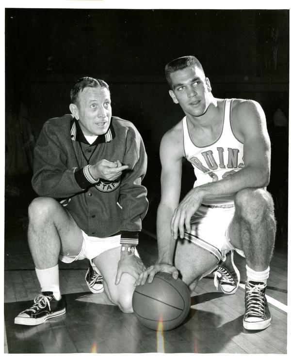 John Wooden conversing with Kent Miller on the court, March 1960