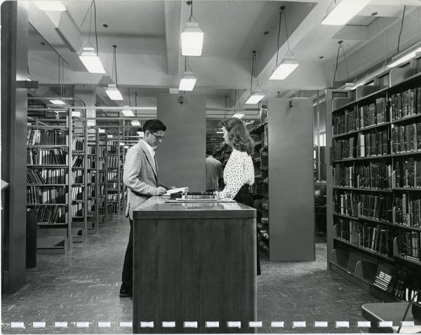 Library patrons browsing shelves and Two men overseeing construction