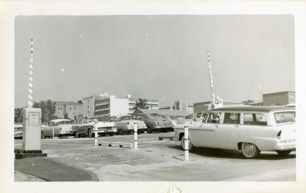Car entering a parking lot, 1958