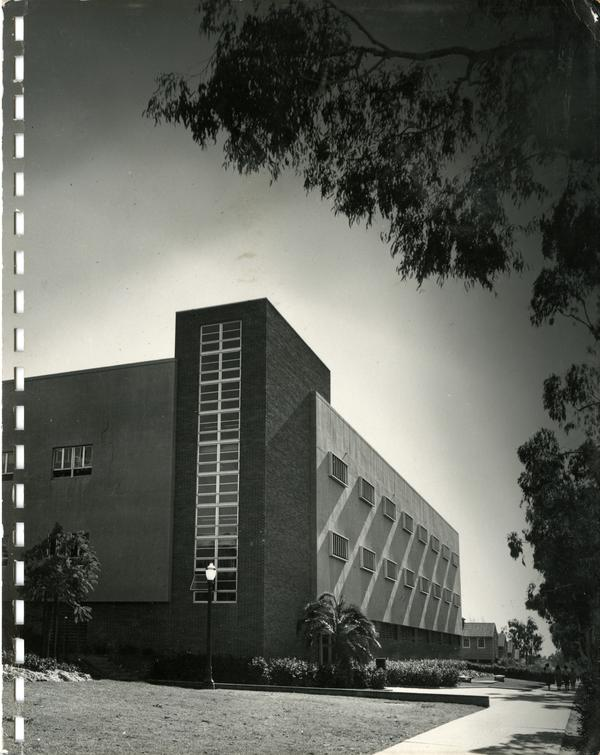 Double-sided image of Boelter Hall exterior; man standing in front of California map