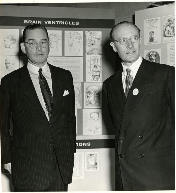 Macdonald Critchley and colleague in front of display on brain ventricles
