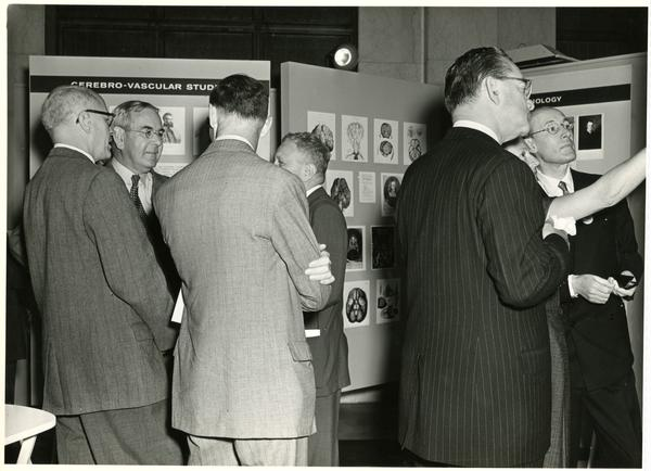 BRI researchers and physiologists conversing at an exhibition