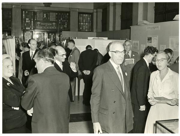 BRI researchers conversing at Museum of Medical Science