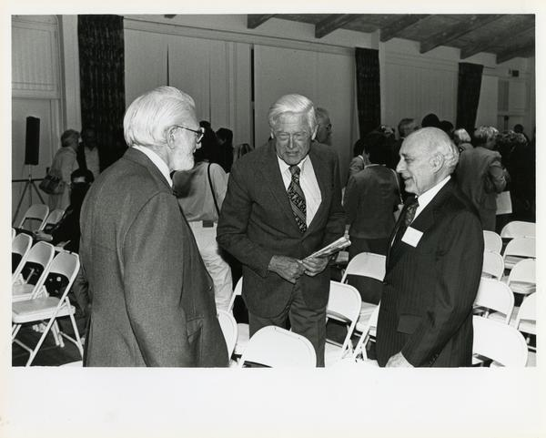 Attendees conversing, Breslow Lecture, 1991