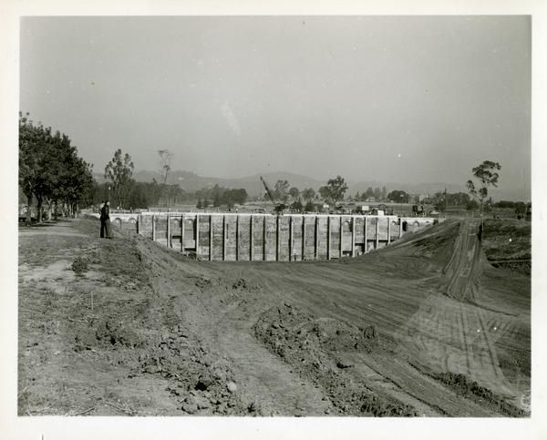 View of construction site of bridge across the deep arroyo