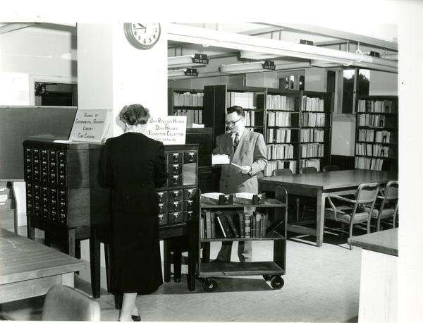 Two Individuals using card catalog in Bureau of Governmental Research library