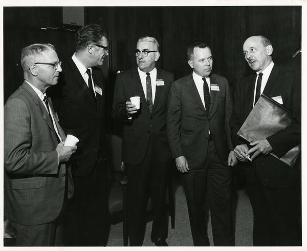 Participants in California Newspaper Publishers Seminar socializing, January 1966