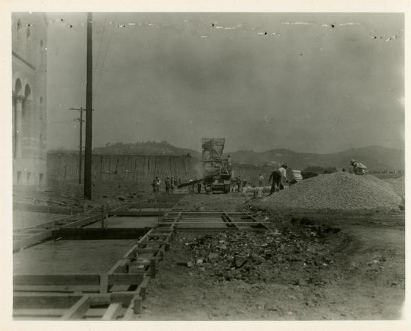 View of men at work during construction of Campbell Hall