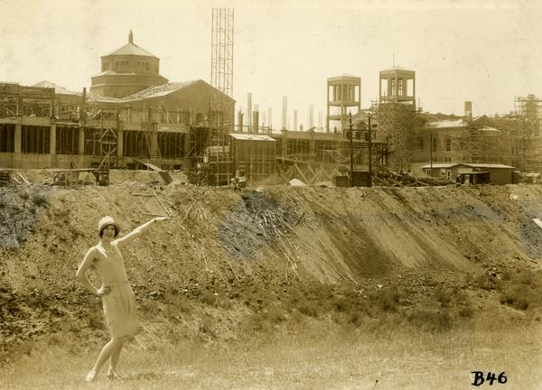 Woman posing in front of Campbell Hall construction site