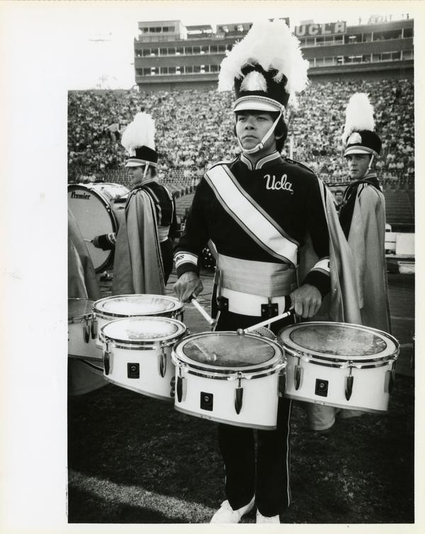 UCLA Marching Band drummer at football game