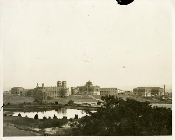 View of Powell Library, Royce Hall and Moore Hall from Bel Air, ca. 1930