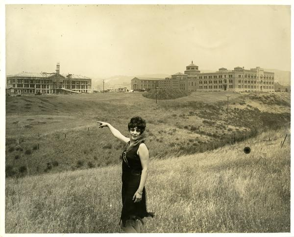 Woman in the foreground points towards the construction of Moore Hall