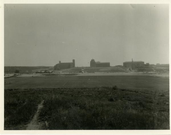 View of Royce Hall and Powell Library from athletic field, ca. 1930