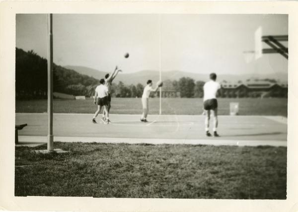 Men playing basketball, June 1943