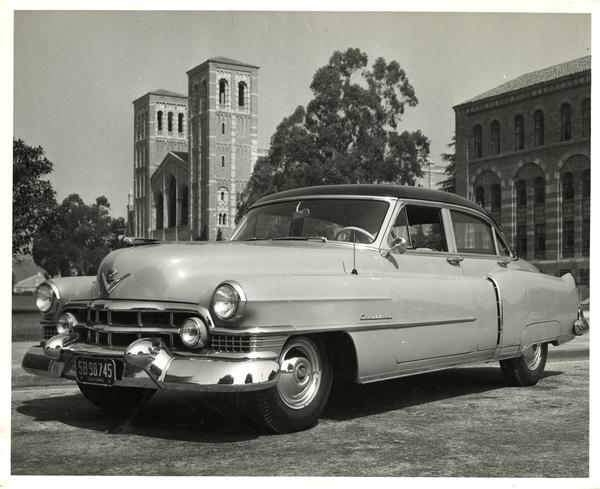 Car parked on campus with Royce Hall in the background, 1951
