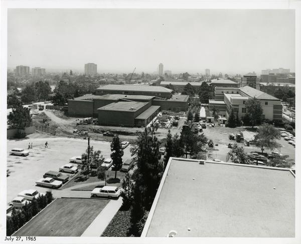 View of UCLA campus buildings and parking lots, July 1965