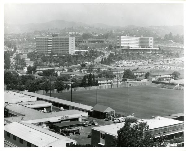 View of the athletic field with Hedrick Hall and Rieber Hall in the background, 1963