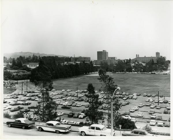 Parking lot with campus buildings in the background, May 1963