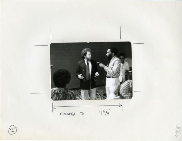 Two men converse at an event for the Center for African American Studies