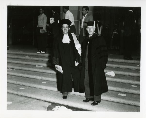 Two men stand on the steps on Charter Day, 1950
