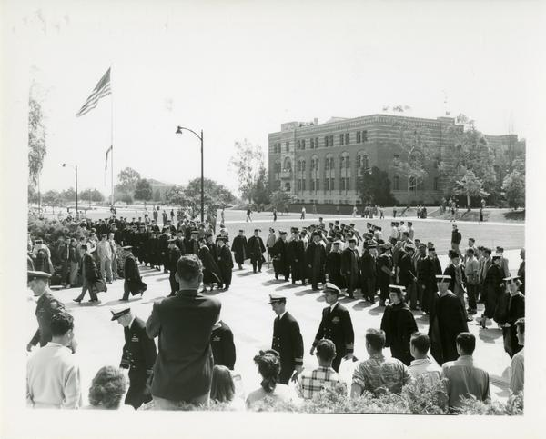 Procession stands outside of Royce Hall on Charter Day, 1950
