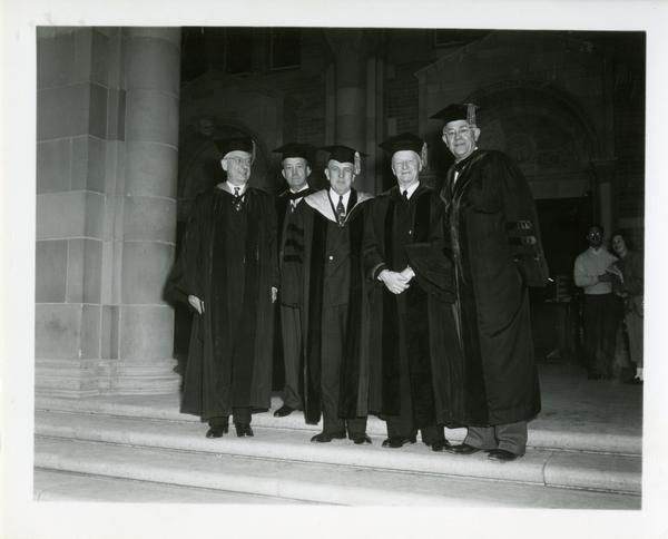 Group of men stand on the steps of Royce Hall on Charter Day, 1950