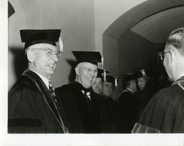 Earl Warren stands with other speakers on Charter Day 1954