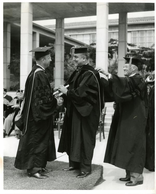 Charles Malik receives honorary degree from President Clark Kerr and Chancellor Vern O. Knudsen on Charter Day 1960