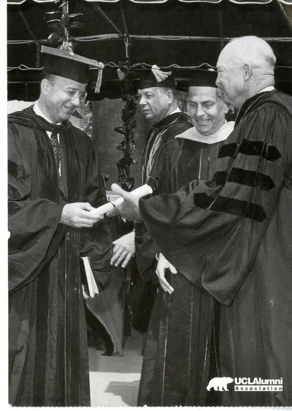 Former President Dwight Eisenhower receiving honorary degree from UC President Kerr and UCLA Chacellor Murphy, Charter day 1963