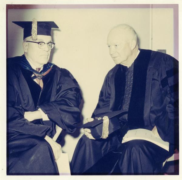 Chancellor Franklin Murphy and former President Dwight Eisenhower in academic gowns, Charter Day 1963