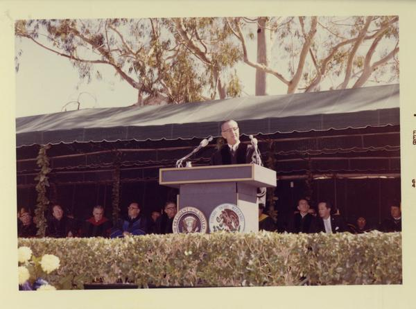 President Johnson speaks at podium on Charter Day 1964