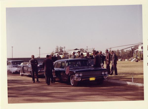 President Johnson entering car on arriving to UCLA campus for Charter Day 1964