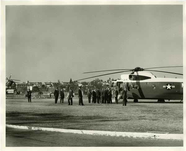 President Johnson descending from presidential helicopter, Charter Day 1964