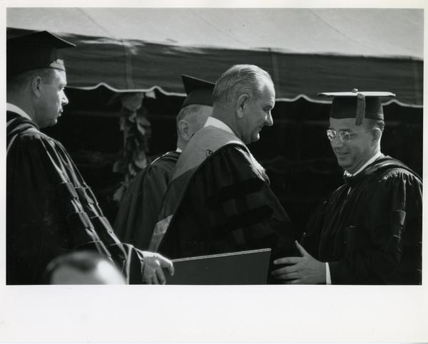 President Lyndon B. Johnson receiving honorary degree from UC President Clark Kerr, Charter Day 1964